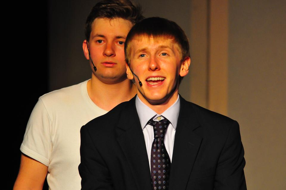 "Adam J. Connor '14 and Karl C. Kopczynski '15 perform a duet in Friday night's showing of ""tick, tick...Boom!"" in Adams Pool Theatre."