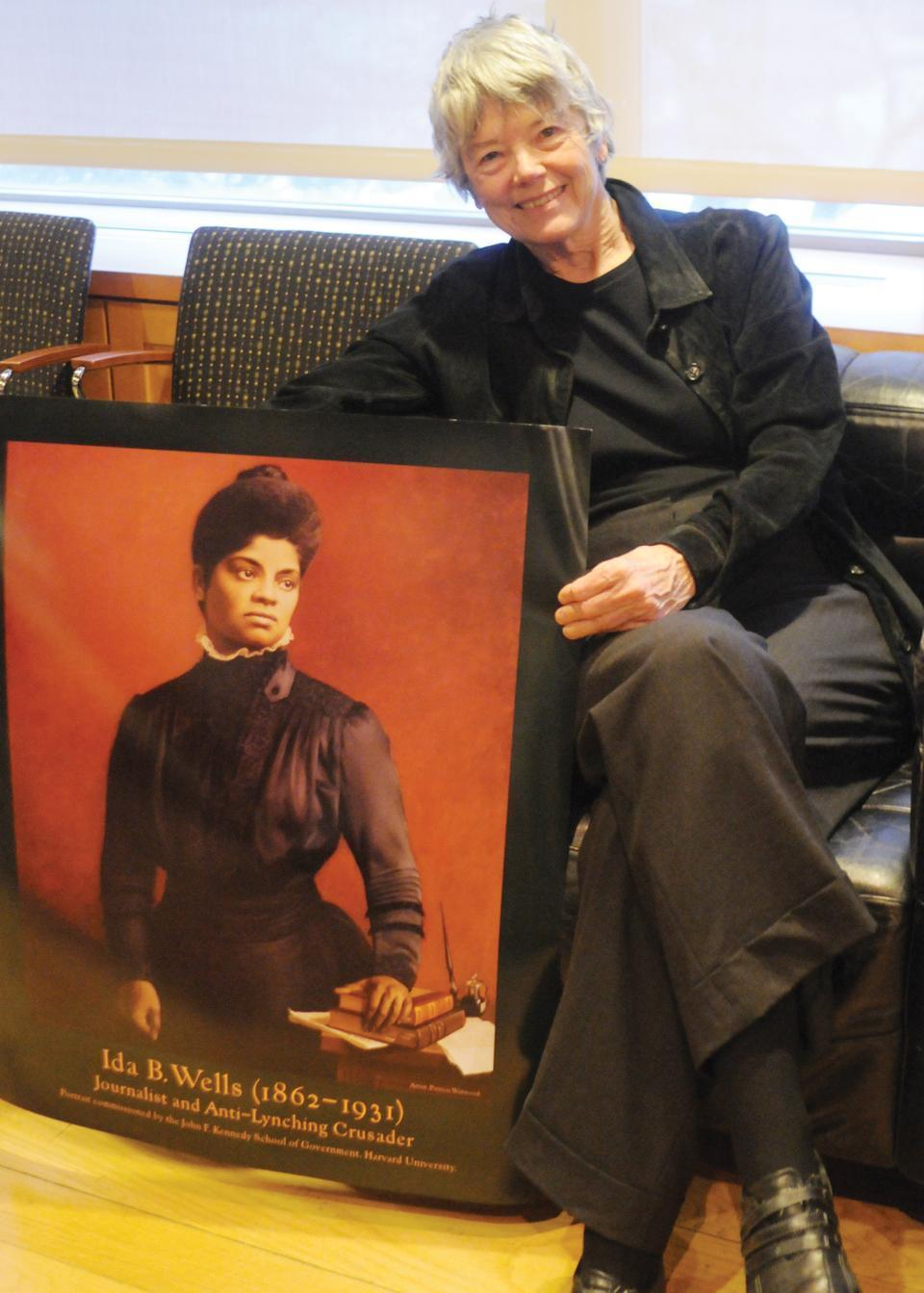 Harvard Kennedy School Professor Jane Mansbridge, pictured here with a poster of Ida B. Wells, speaks on how women in history measure just as profoundly as men do.