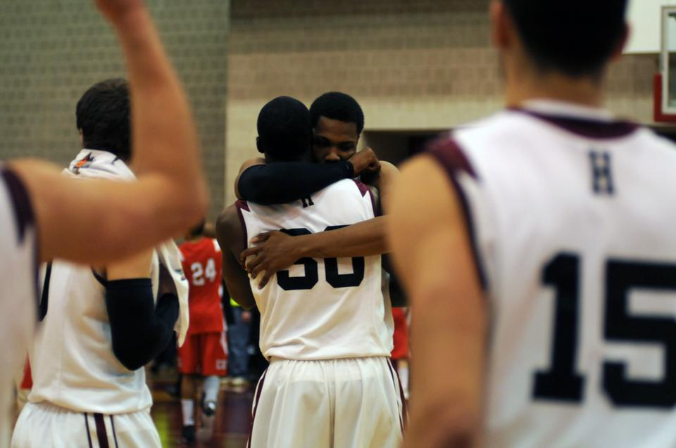 Co-captain Keith Wright hugs junior forward Kyle Casey after the pair led the Crimson to a 67-63 victory over Cornell Saturday evening, helping Harvard clinch at least a share of its second-ever Ivy League championship.