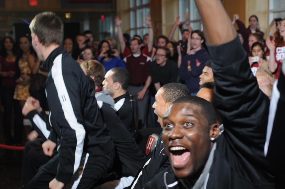 The Harvard men's basketball celebrates after the announcement of its NCAA tournament seeding at the Murr Center Sunday evening.