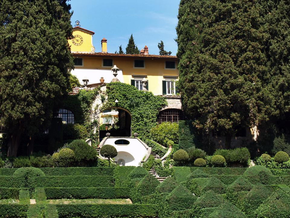 Villa I Tatti is seen behind the limonaia with the Italian garden in the foreground.