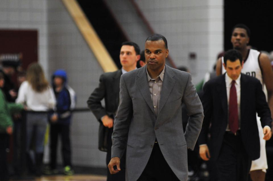 In this February 24, 2012 Crimson file photo, head coach Tommy Amaker walks on court after a 67-64 win against Princeton at Harvard's Lavietes Pavilion.