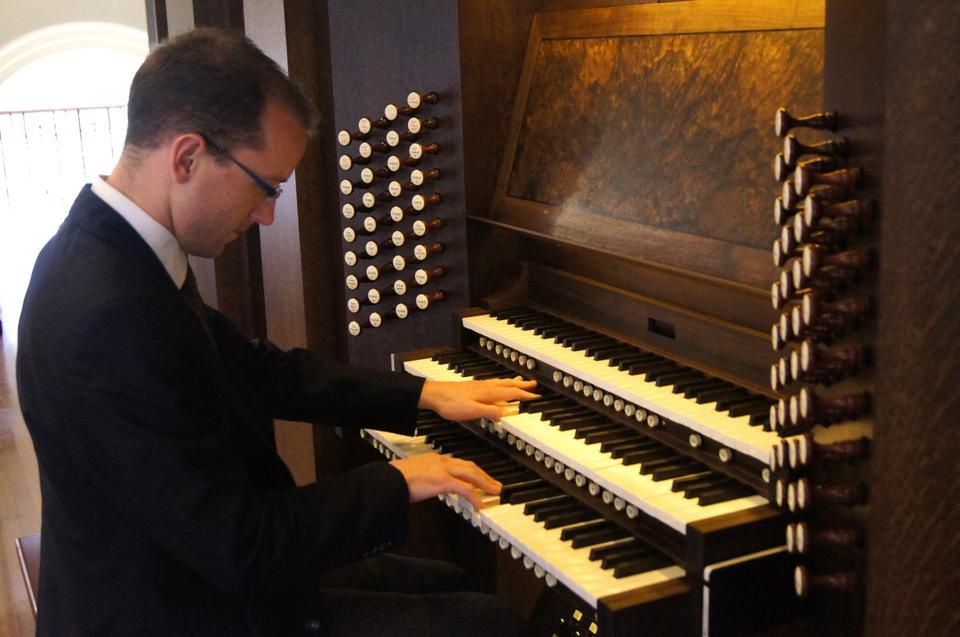 Assistant University Organist and Choirmaster and musician Christian M. Lane performs on the new pipe organ at Memorial Church, which was debuted to the public on Sunday, April 8.
