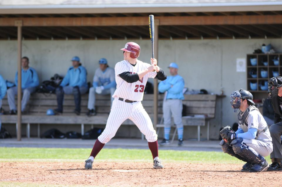 Senior Marcus Way, shown here in earlier action, went 3-for-3 with 2 RBIs to lead the Harvard baseball team to a 6-5 win in game one of Saturday's twinbill against Brown. The Crimson fell 22-9 in game two.