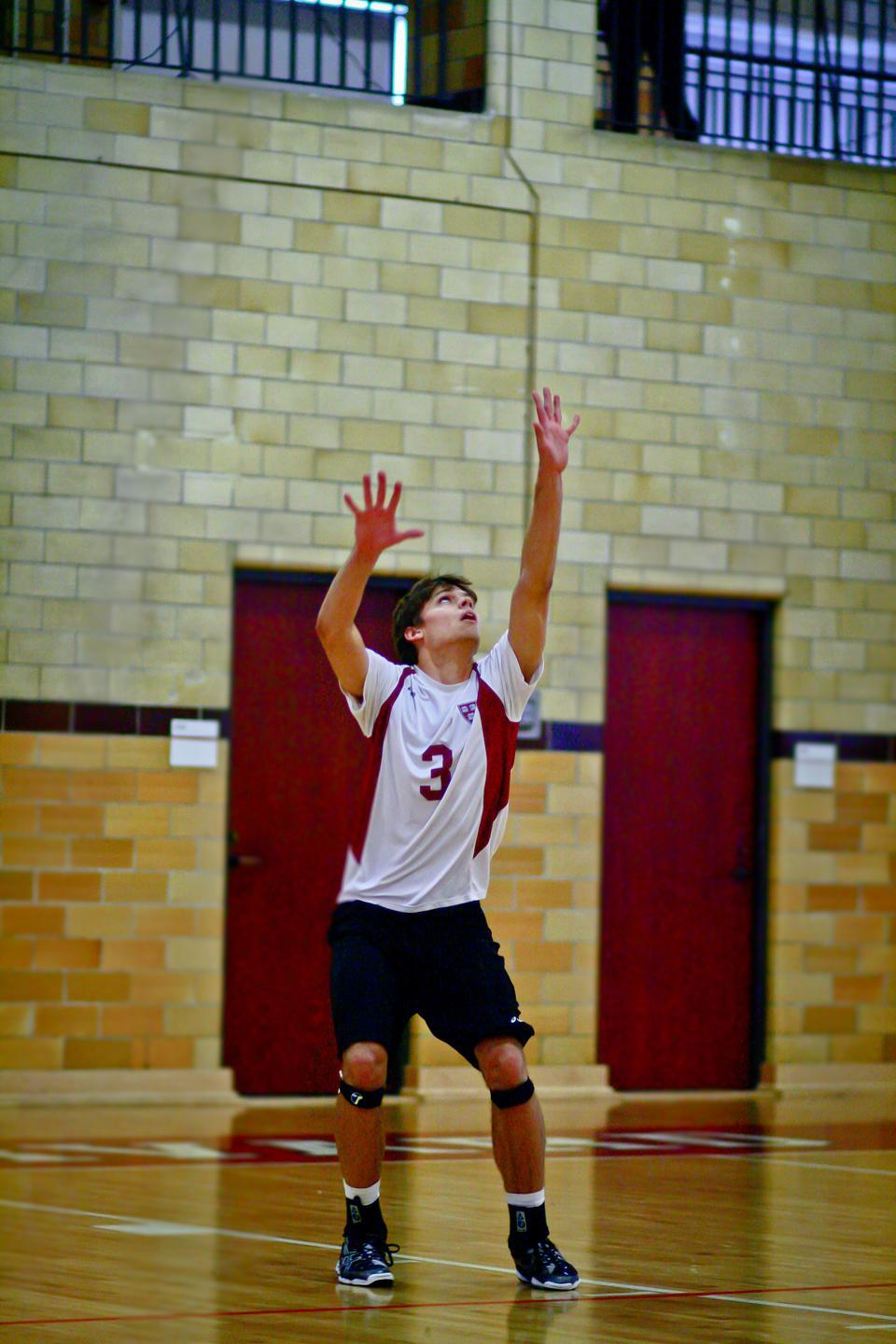 The Crimson defense, including freshman Will Chambers, shown above in earlier action, was unable to stop the George Mason attack on Thursday. Harvard fell to the Patriots in straight sets, which eliminated the squad from the Eastern Intercollegiate Volleyball Association Playoffs.