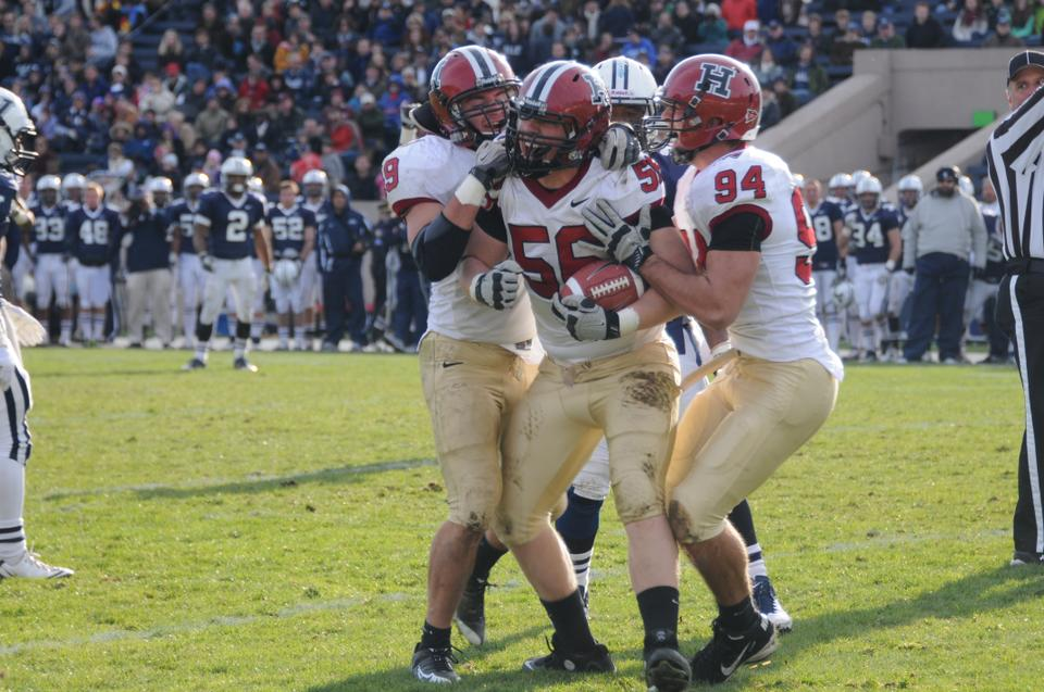 Sophomore defensive tackle Jack Dittmer celebrates after intercepting a Patrick Witt pass in the Harvard  football team's annual contest against Yale. The Crimson routed the Bulldogs 45-7 in the 128th playing of The Game.