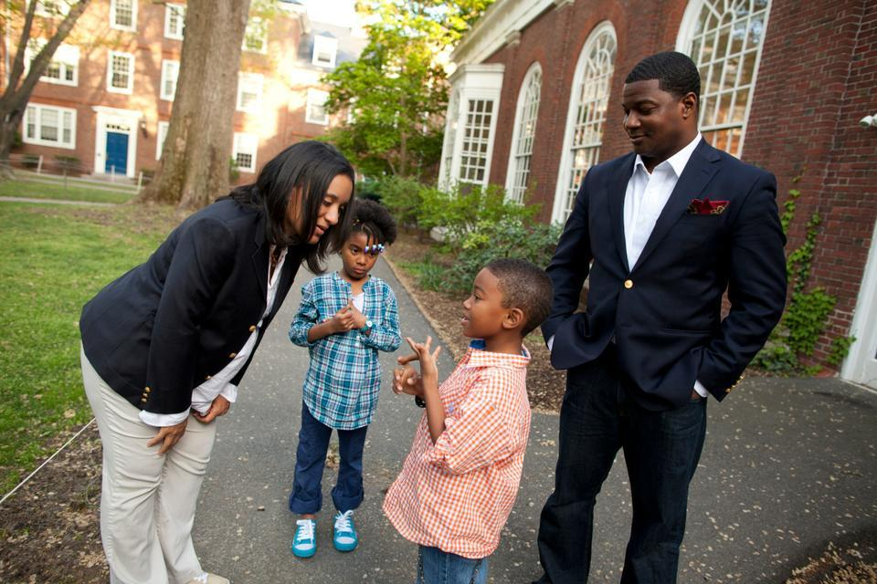 Minister Jonathan L. Walton poses with his wife, Cecily Cline, and children, Elijah Mays and Zora Neale, for a photo. Minister Walton aims to integrate the religious population into the greater Harvard community.