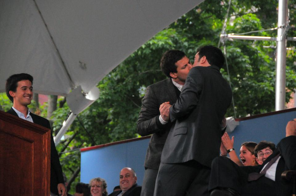 """Class Day speaker Andy Samberg plants a kiss on Matthew J. DaSilva '12 on Wednesday afternoon. Class Marshal DaSilva, introduced the comedian, who entertained the graduating class with a list of """"useless"""" majors and an impression of fellow actor Nicolas Cage."""