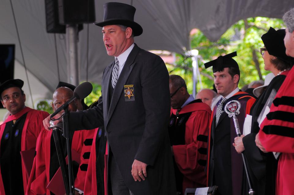Peter J. Koutoujian, the Sheriff of Middlesex County, rises to adjourn the Commencement exercises. The Sheriff's formal orations of the start and dismissal of Commencement is a tradition that dates back to the seventeenth century.
