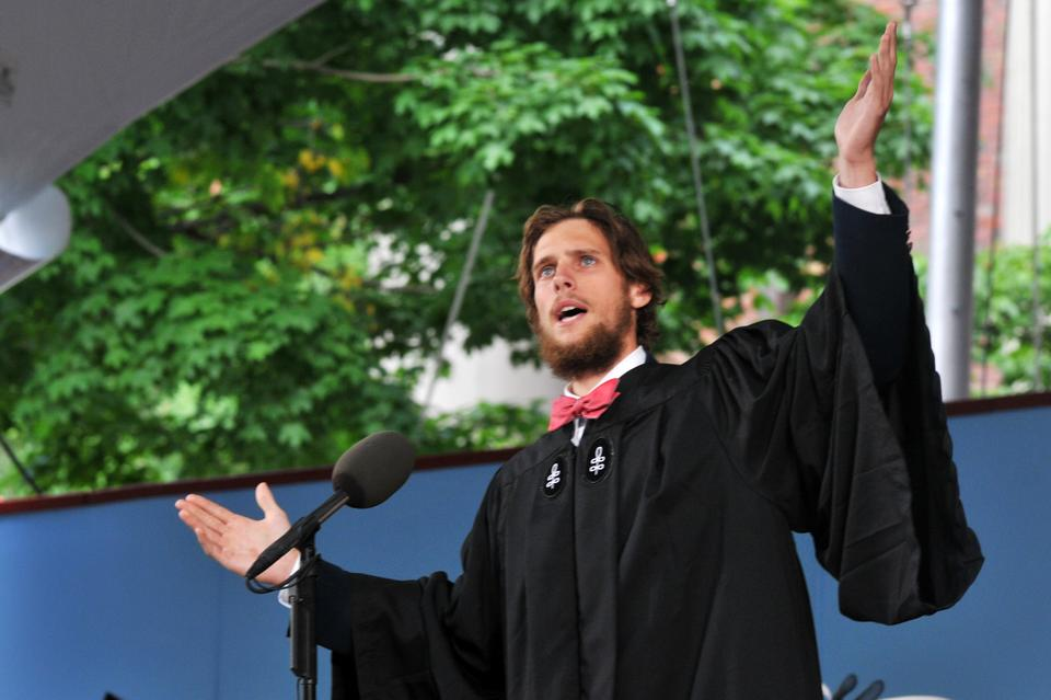 Michael K. Velchik, graduating senior from Dunster House, delivers an animated Latin Salutatory at Harvard's 361st Commencement on Thursday morning in Tercentary Theatre.