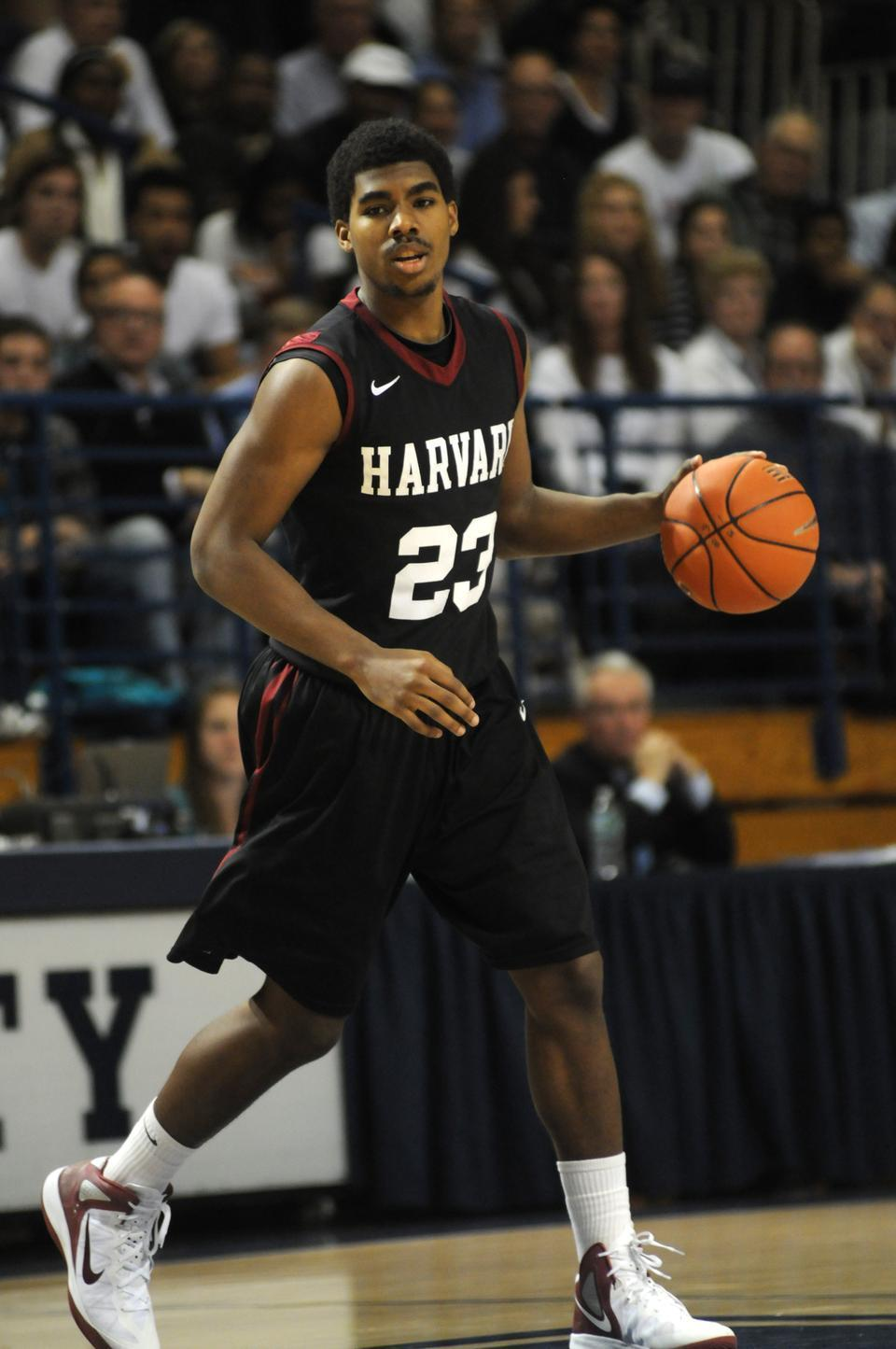 Shown here in earlier action, sophomore wing Wes Saunders scored a team-high 16.5 points per game in the Harvard men's basketball team's four contests in Italy.
