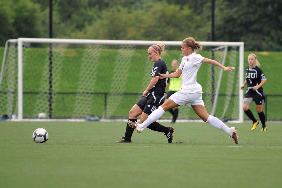 Junior co-captain Peyton Johnson, shown above in earlier action, handed out an assist during the Harvard women's soccer team's 3-1 loss to Dayton on Friday at Soldiers Field Soccer/Lacrosse Stadium.