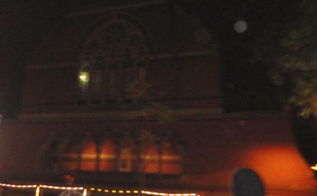 What is supposedly a ghost peeking through a window of Memorial Hall.