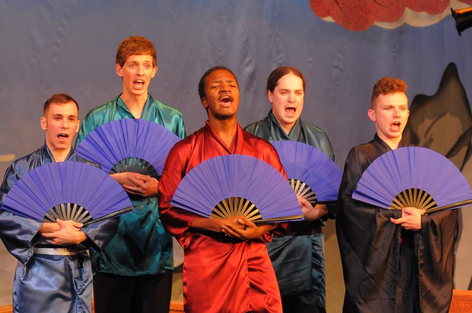 The Harvard-Radcliffe Gilbert and Sullivan players perform a scene from The Mikado, a 19th-century Victorian operetta set in Japan. The show opened Friday night at the Agassiz Theatre.