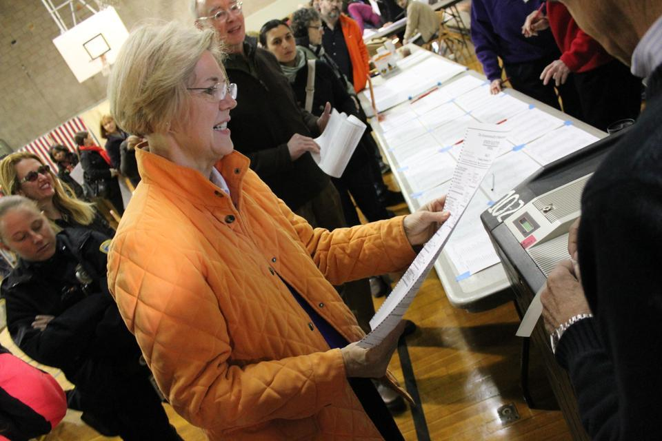 Elizabeth Warren looks over her ballot one last time before casting her vote at the Graham and Parks School polls on Tuesday morning in Cambridge, Mass.