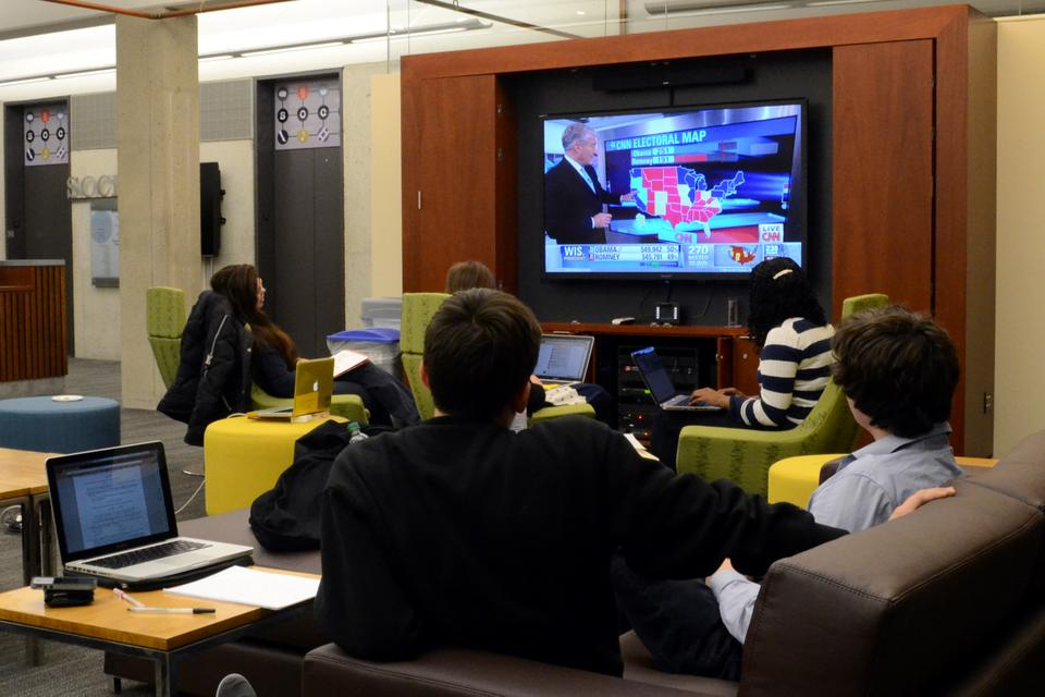 Students watch presidential election projections in the SOCH