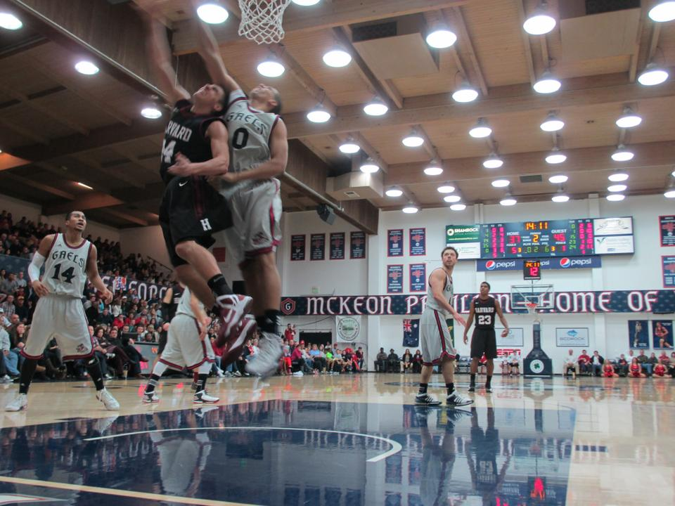 Sophomore Jonah Travis makes a tough layup from under the basket.