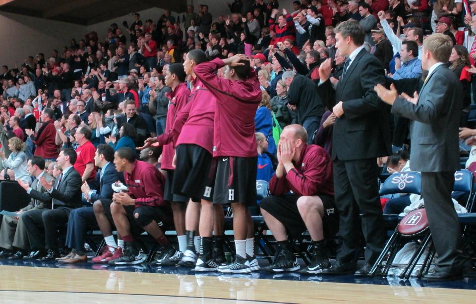 The Harvard bench looks in awe as Harvard gives up the lead in the final second of the Crimson's 70-69 loss to St. Mary's. Harvard finishes its California road trip 1-1.
