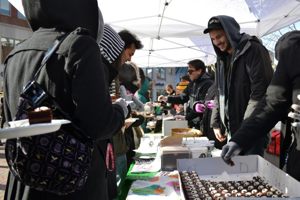 In celebration of Harvard Square's annual Chocolate Festival, local restaurants congregate to hand out free chocolate samples to a long line of people braving the cold weather for sweets and coupons.
