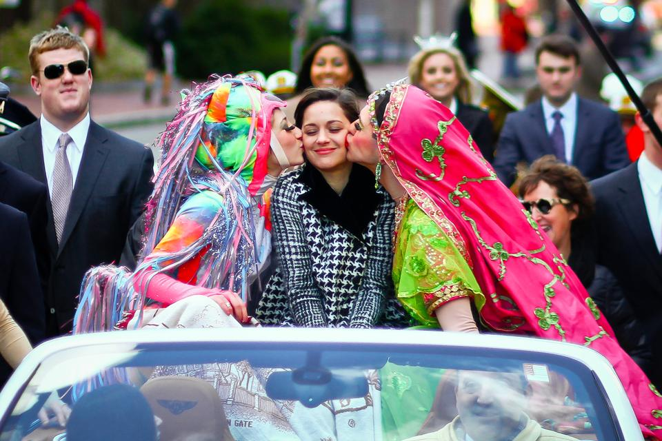 Marion Cotillard received a kiss from Hasty Pudding Theatrical President Renee Rober '13 and Vice President Ben Moss '13.