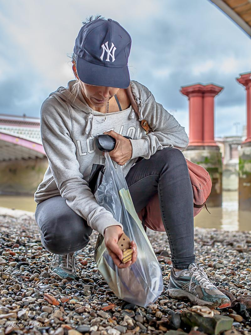 Michelle Erickson collects artifacts on the bank of the Thames River in London for use in her work.