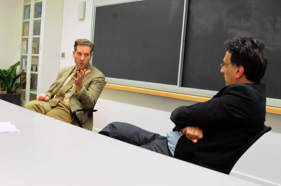 """Moderator Roilos Panagiotis watches as Harvard Law School professor Noah Feldman discusses the rise of Salafi Islam among youth in Tunisia on Wednesday. His talk """"The Politics of Islamic Cultures in the Wake of the Arab Spring"""" was sponsored by the Weatherhead Center for International Affairs."""