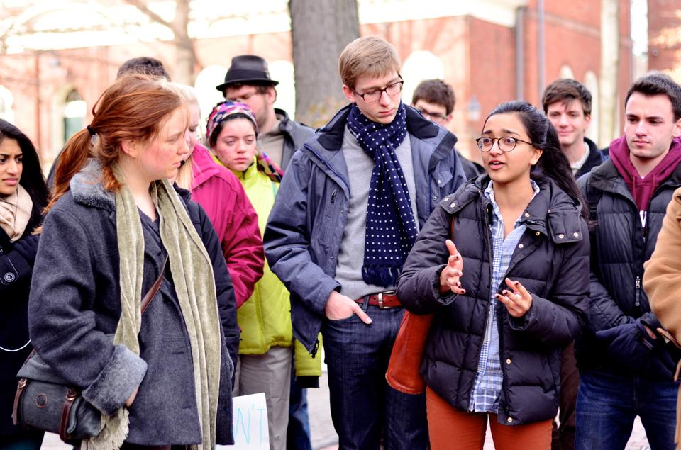 Undergraduate Council President Tara Raghuveer '14 voices her support of the Mental Health Rally outside of Massachusetts Hall on Friday afternoon. A large crowd gathered at 2 p.m. to address the concerns surrounding Harvard's current Mental Health policy.