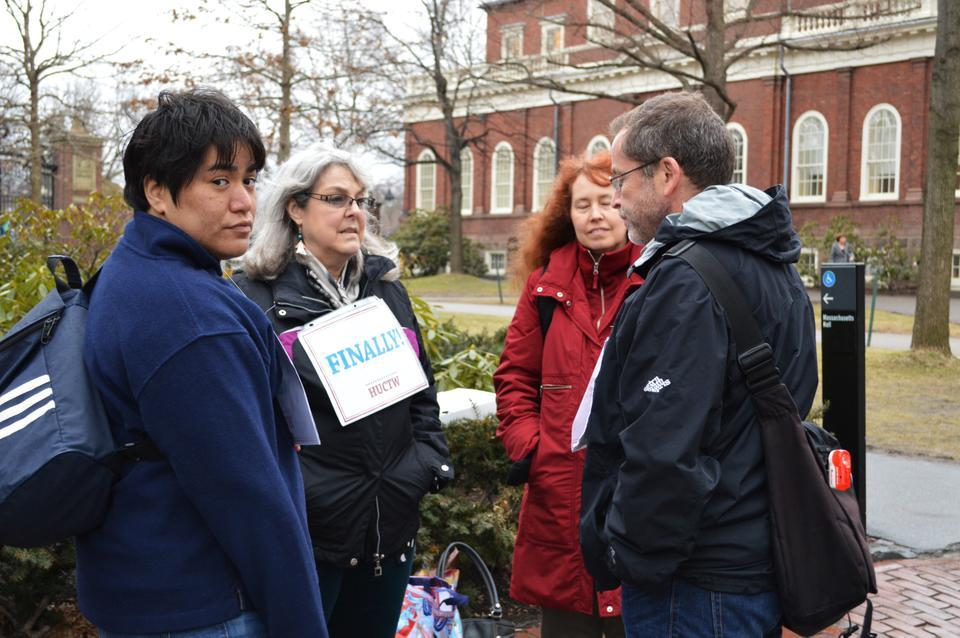 Members of The Harvard Union of Clerical and Technical Workers gather in front of Massachusetts Hall on Tuesday afternoon.  They were celebrating the new contract made with the University, which ended the longest negotiations in the union's history.
