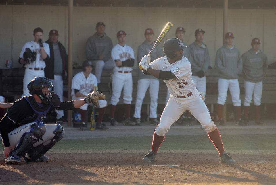 Senior utilityman Carlton Bailey, shown here in previous action, leads the Crimson with a .323 batting average so far this season. Harvard begins its Ivy League season this Saturday with a road doubleheader against Princeton.