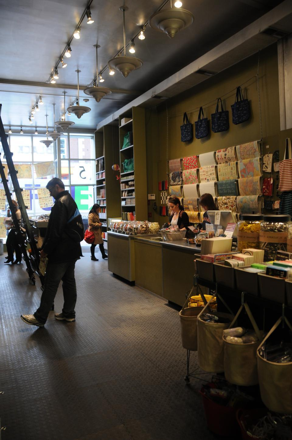 Can designing the interiors of stores and displays be considered an art?