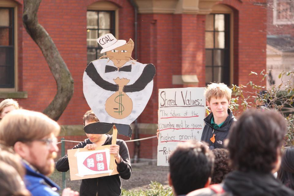 Thursday afternoon students assemble outside Massachusetts Hall to call for Harvard to divest from investments in Fossil Fuels.