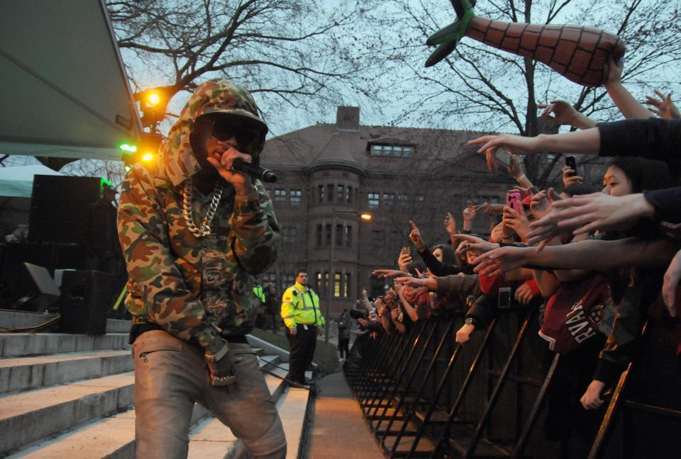 Students clamor for hip-hop artist Tyga at this year's annual Yardfest held in Tercentenary Theatre.  Hosted  by the Office of Student Life, the concert brought with it sizable controversy about the artists' lyrics.
