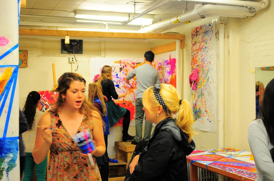 Sarah Moon '15, the co-founder of Cabot Arts Space, talks to the attendees at its opening on April 12.