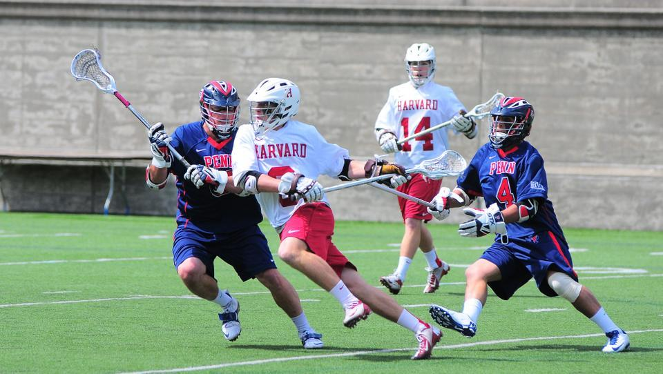 The Harvard men's lacrosse team, pictured in earlier action, suffered a defeat at the hands of Duke on Saturday.