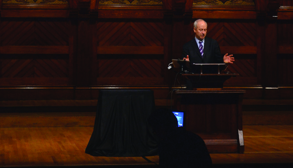 "Government professor Michael J. Sandel delivers a ""Justice"" lecture in Sanders Theatre in a December 2012 file photo. Sandel's teaching in the edX ""Justice"" course was criticized by philosophy professors at San Jose State University."