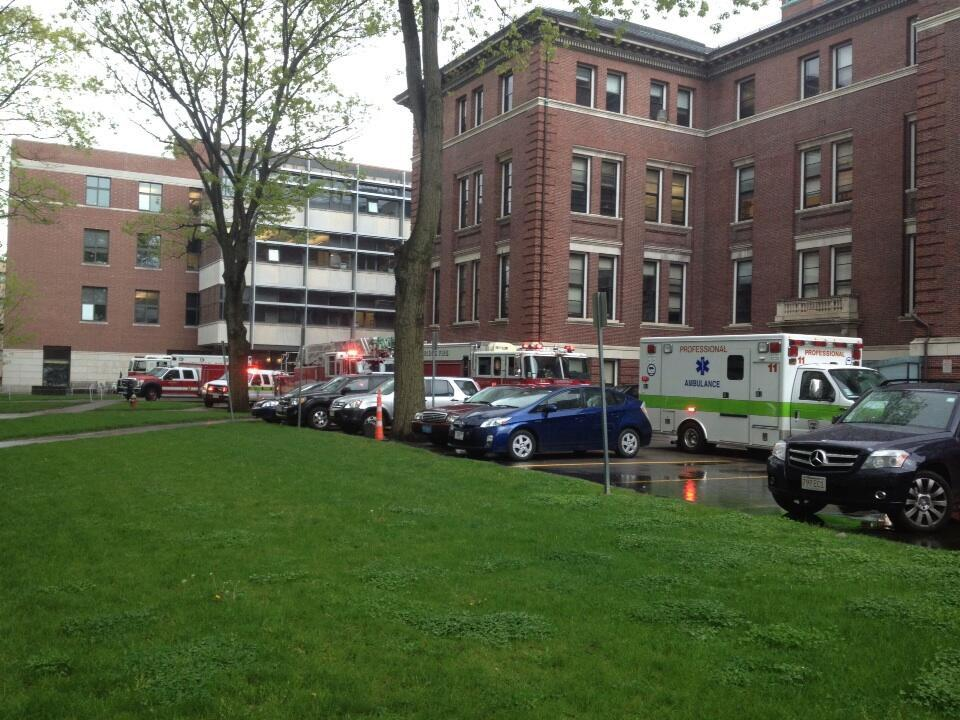 Emergency vehicles, including Boston Fire Department's hazardous materials team, are stationed outside the Law School's Hauser Hall Thursday afternoon. The fifth floor of the building was evacuated after an envelope sent to Law School Professor Alan M. Dershowitz was found to contain suspicious white powder.