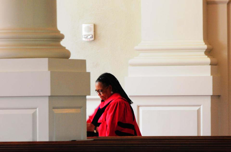 Dean Evelynn M. Hammonds walks around Memorial Church before the Baccalaureate Service on Tuesday.  Dean Hammonds's resignation was officially announced Tuesday morning.