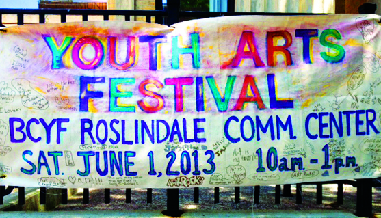 A banner for the Youth Arts Festival at the Roslindale Community Center. The festival is part of broader efforts to reinforce the importance of the arts even as budgetary concerns put them increasingly on the chopping block.
