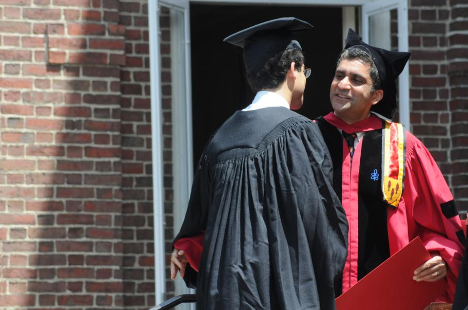 Cabot House co-master Rakesh Khurana, who will become Dean of the College on July 1, is pictured greeting a graduating senior during 2012 Commencement.