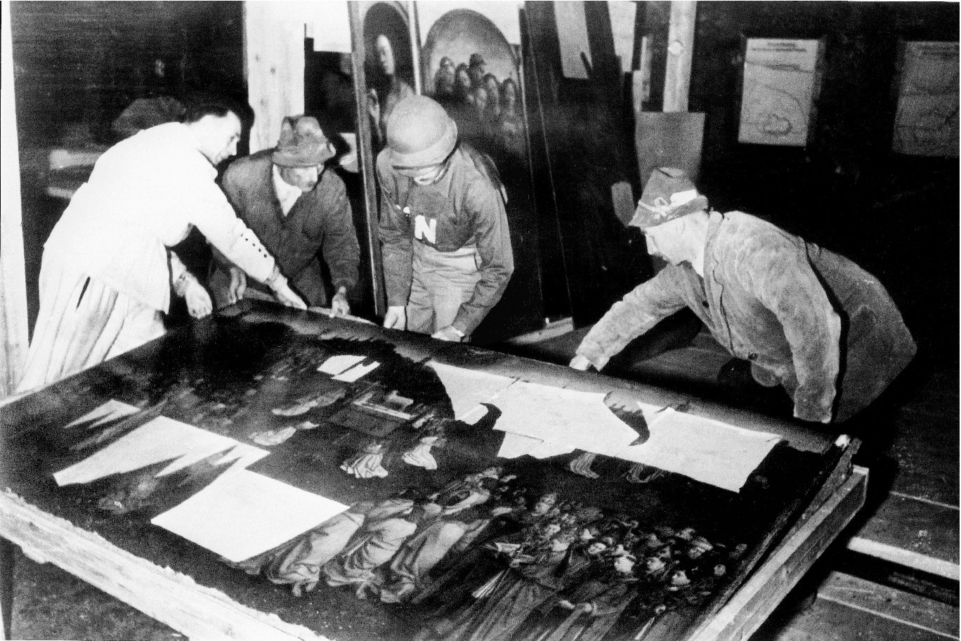 George L. Stout '29 and other soldiers move the Ghent Altarpiece through narrow underground passages in Austria.