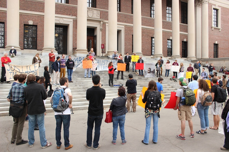 Students advocating for responsible investment tactics protest on the steps of Widener Library.