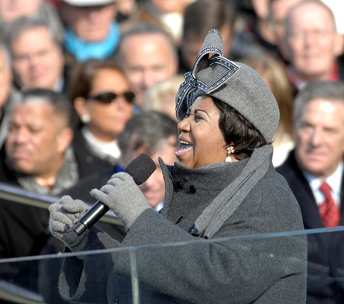 Aretha Franklin with a bow on her head.