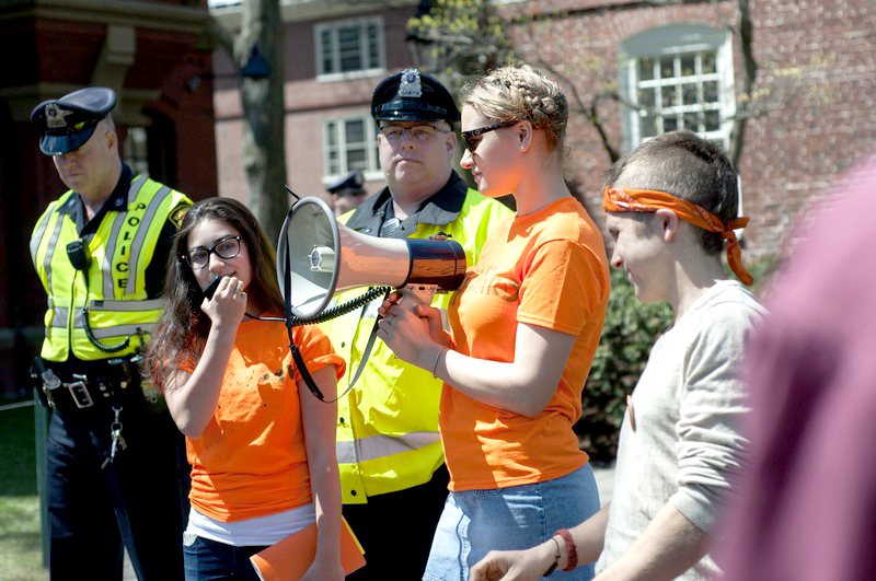 Members of Divest Harvard, including Brett A. Roche '15, far right, who was arrested during a protest two days prior, returned to Massachusetts Hall on May 2, 2014 to renew their call for an open meeting with the Harvard Corporation.