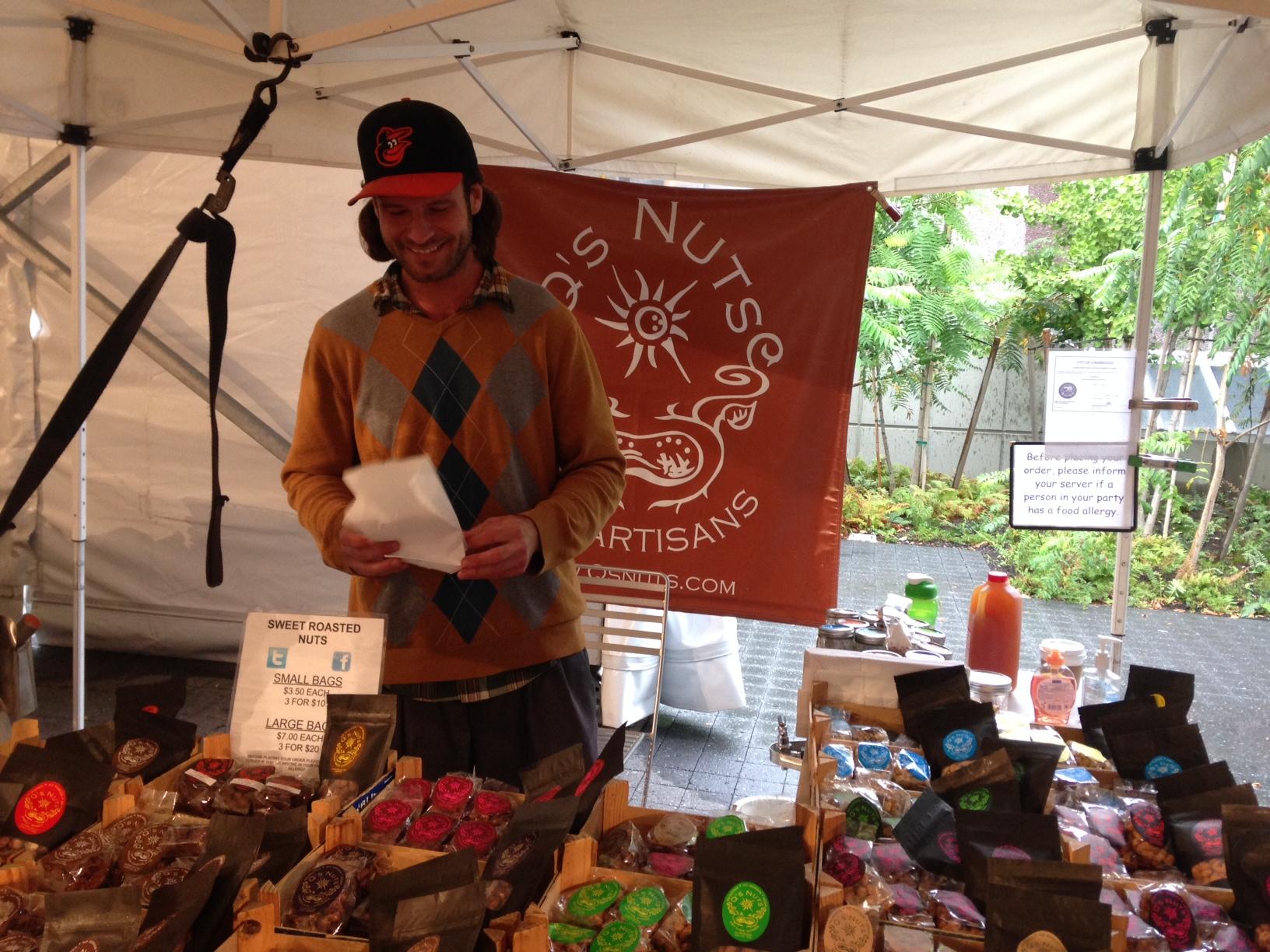 Eric Q. Doyle sells nuts at the Harvard Farmer's Market.