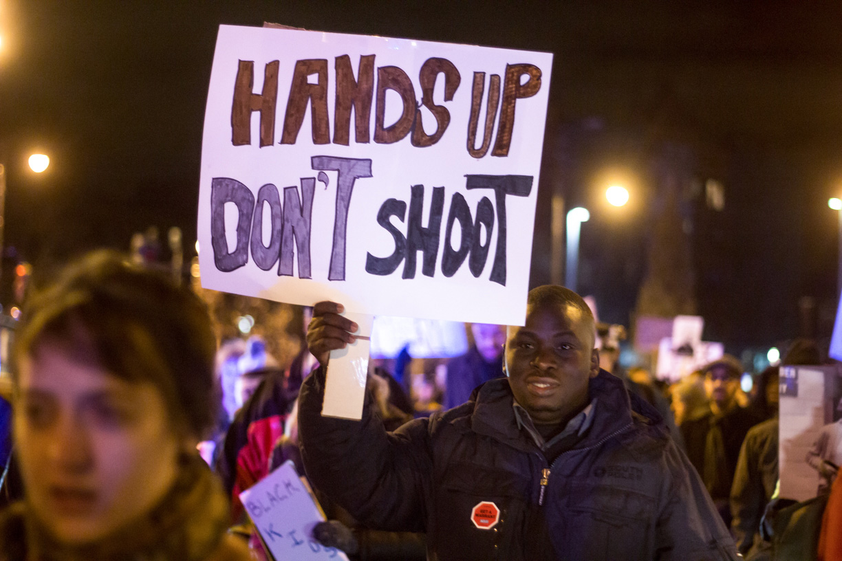 A protestor holds up a sign at the Black Lives Matter protest in Central Square during a January demonstration.