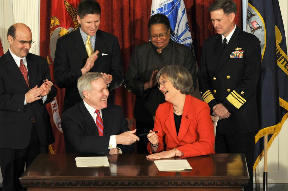 Navy Secretary Ray E. Mabus (seated, left) and Harvard University President Drew G. Faust (seated, right) signed an agreement in March 2011 to re-establish Naval ROTC at Harvard after nearly 40 years of absence due to Harvard's non-discrimination policy.