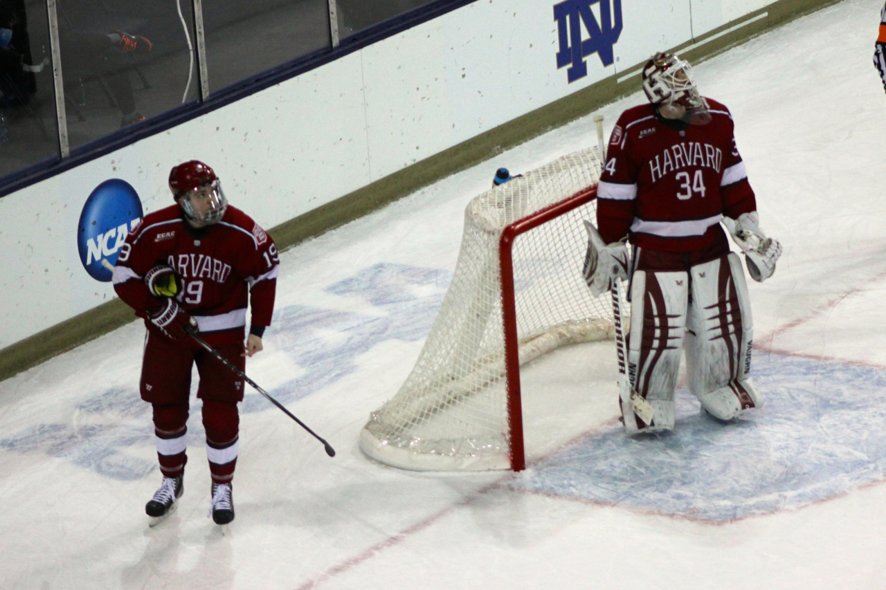 Forward Jimmy Vesey (left) and goaltender Steve Michalek (right) react to Avery Peterson's last-second power play goal to put Nebraska-Omaha up, 2-0, at the end of the first period on Saturday in the NCAA tournament Midwest Regional in South Bend, Ind.