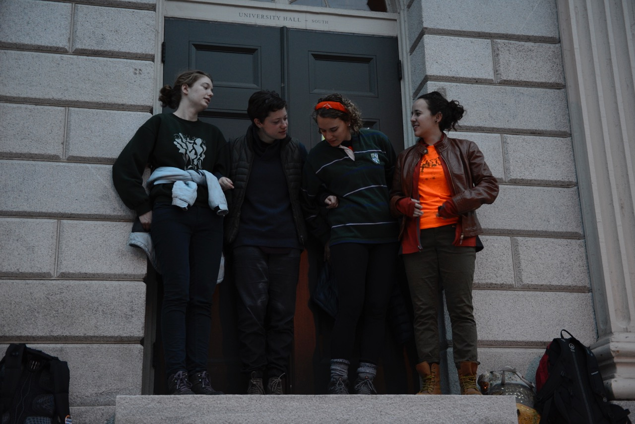 Protesters demanding that Harvard divest its endowment from fossil fuel companies began a blockade of University Hall early Tuesday morning.