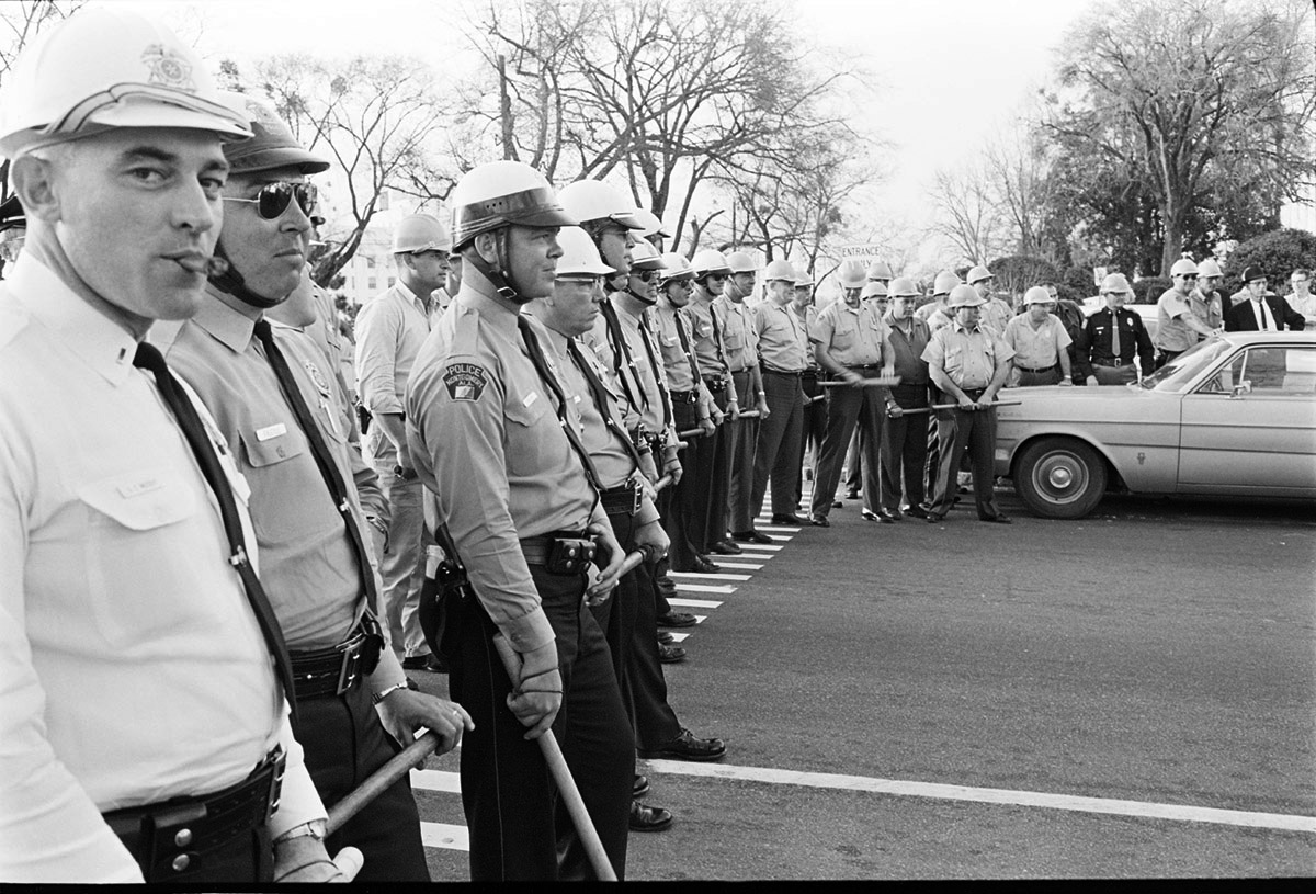 Montgomery police waited for demonstrators on March 17 and 18, 1965 during the voting rights march from Montgomery to Selma. This photograph appeared in The Crimson later that month.