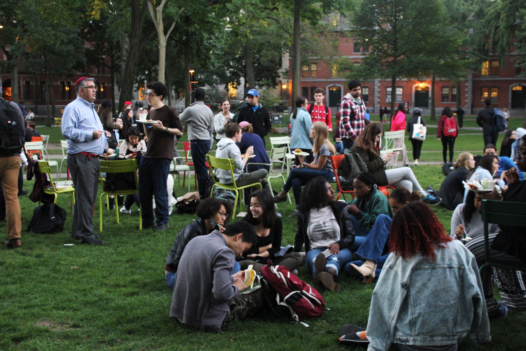 Students show support for striking HUDS employees by eating dinner in Harvard Yard Thursday evening. The dine-in was organized by Harvard Student Labor Action Movement in support of the HUDS workers' ongoing strike.